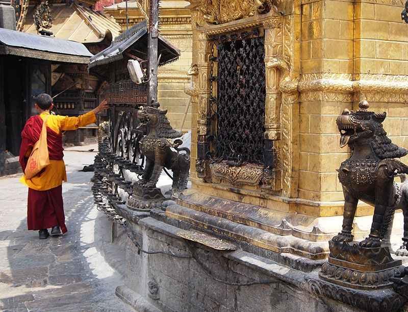 bhutan-monk-prayerwheel