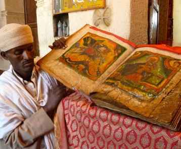 priest-and-manuscript-lalibela