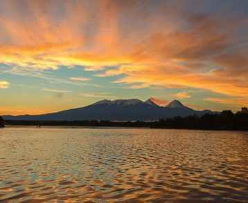 Beautiful sunrise over volcanoes Kluchevskaya group with reflection in the