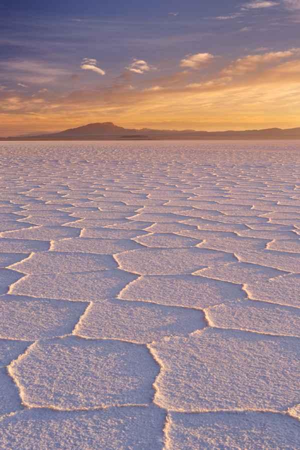 Salt flat Salar de Uyuni in Bolivia at sunrise