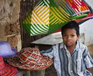 Boy at hat stall - Madagascar