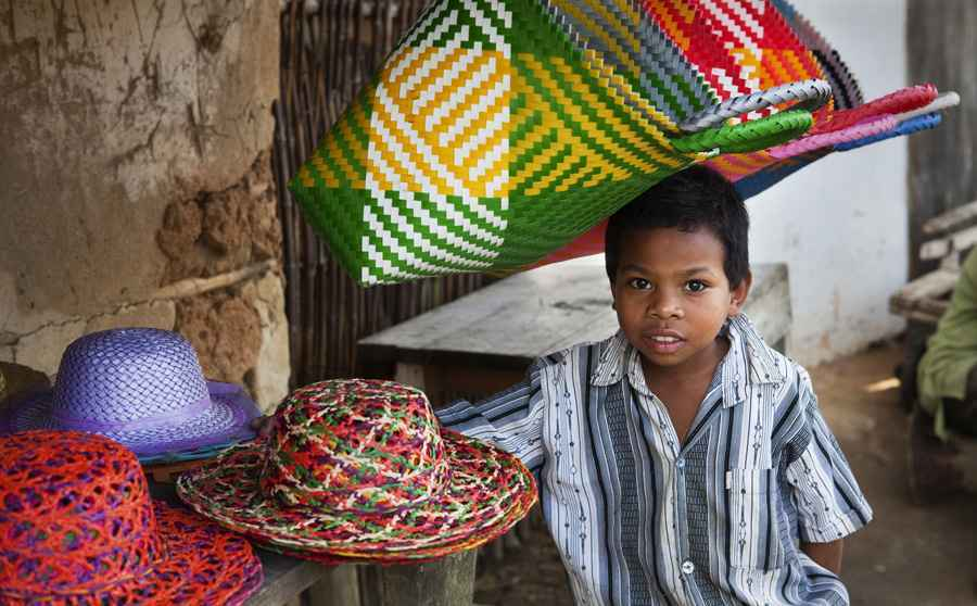 Boy at hat stall - Madagascar