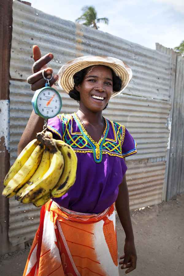 Lady with bananas, madagascar