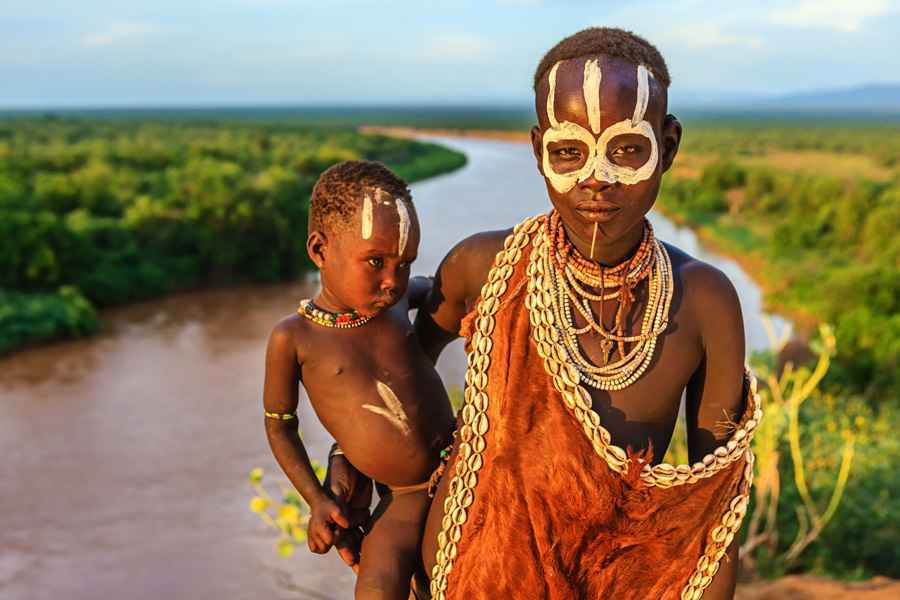 Woman from Karo tribe holding her baby, Ethiopia, Africa