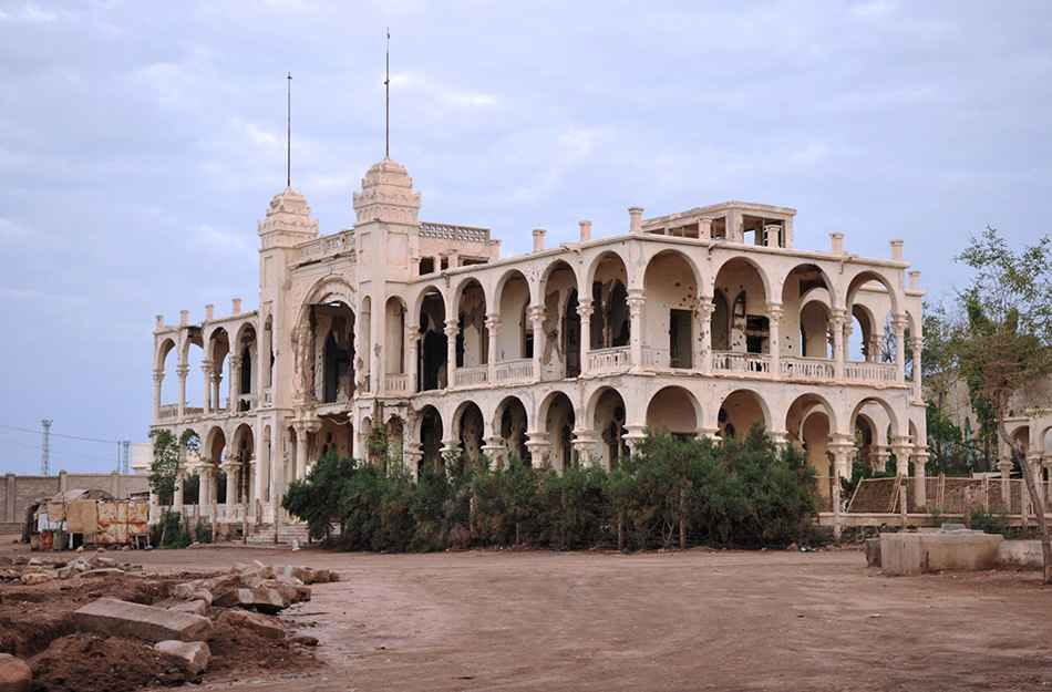 Eritrea, battered former Italian bank, Massawa in the evening sun