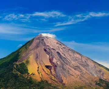 View of Conception Volcano's colorful ash deposits and green slopes, Nicaragua